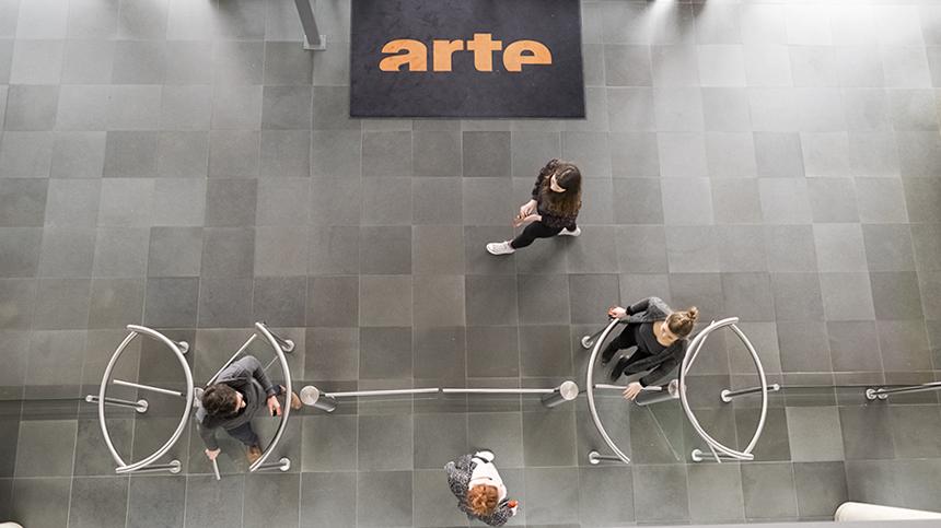 People walking in the ARTE building