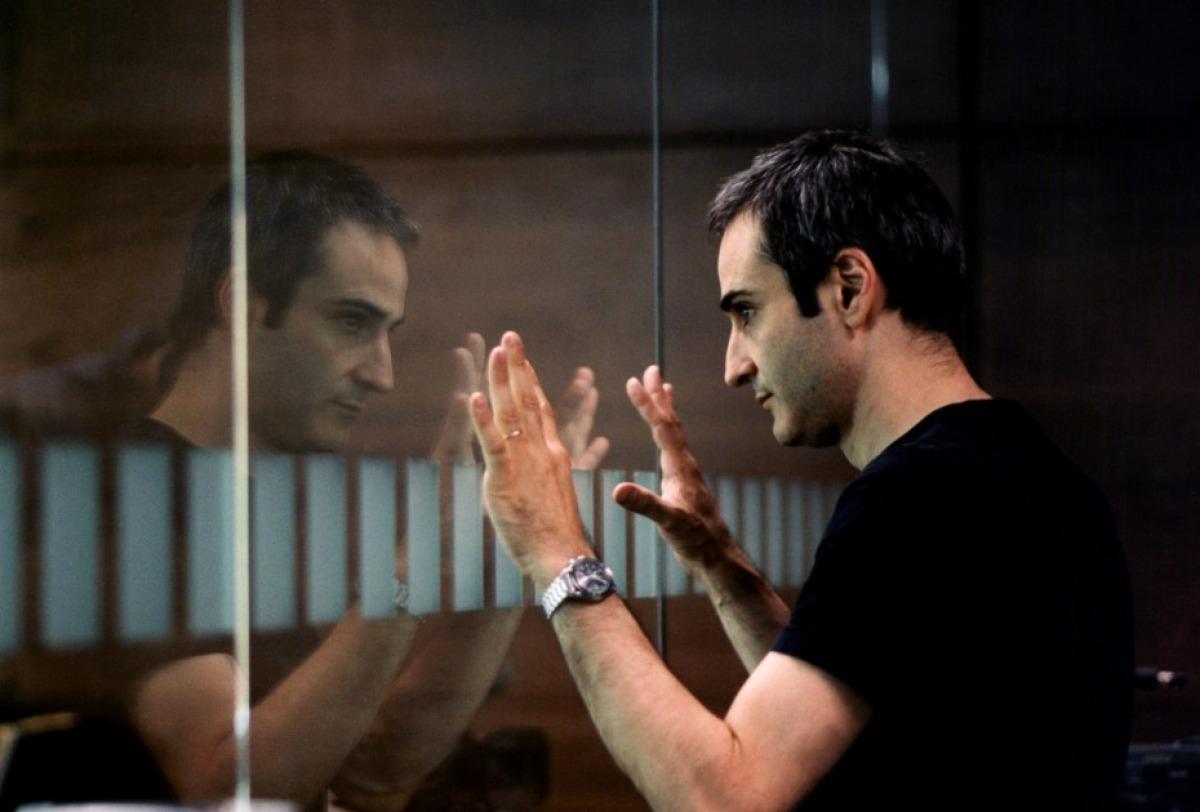 Olivier Assayas sur le tournage de Demonlover