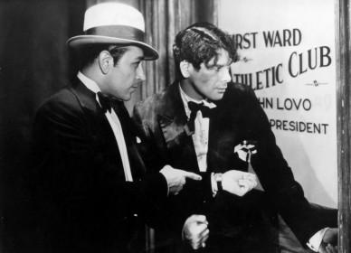 George Raft et Paul Muni dans Scarface