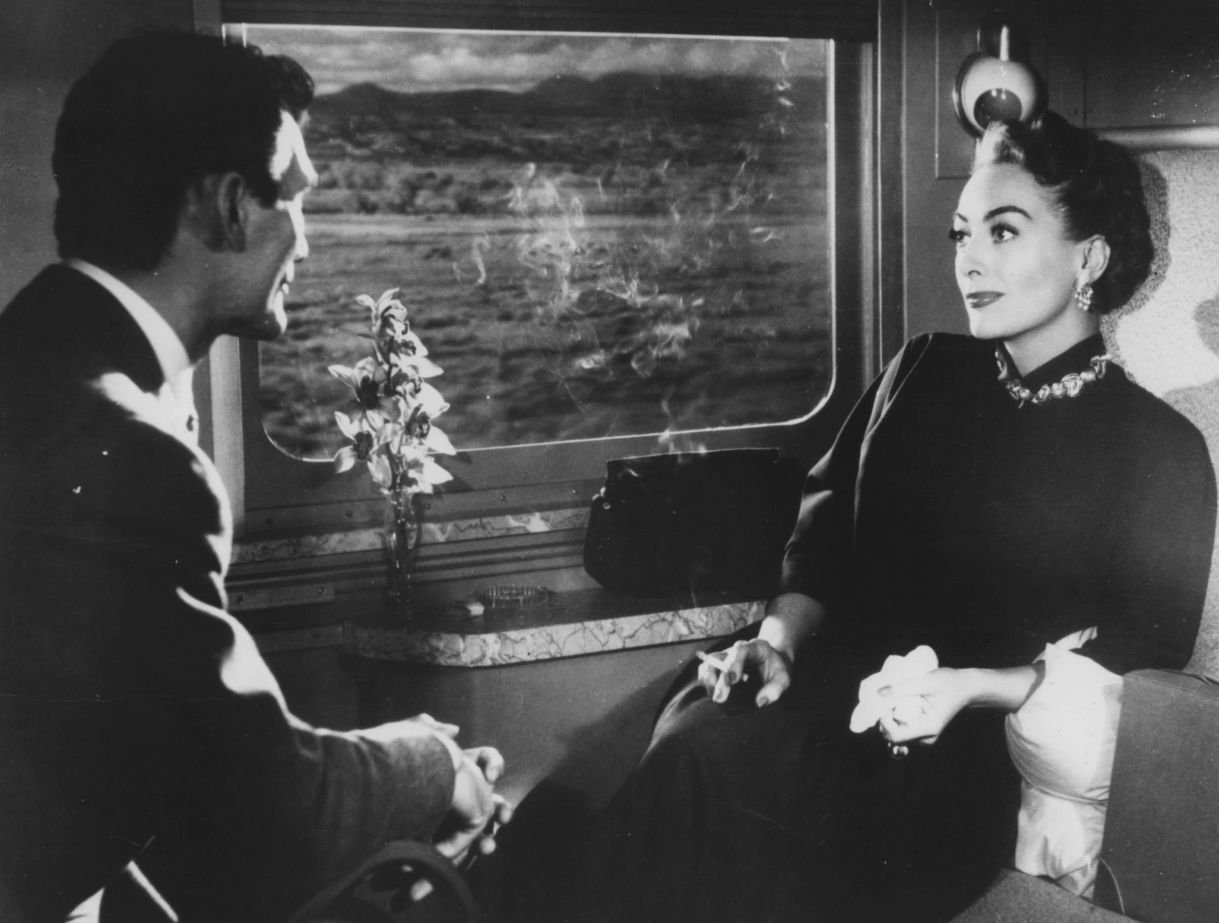 Jack Palance et Joan Crawford dans Le Masque arraché